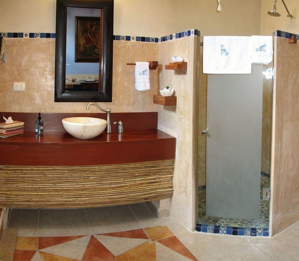 bathroom property cabinetry plumbing fixture Suite flooring bathtub