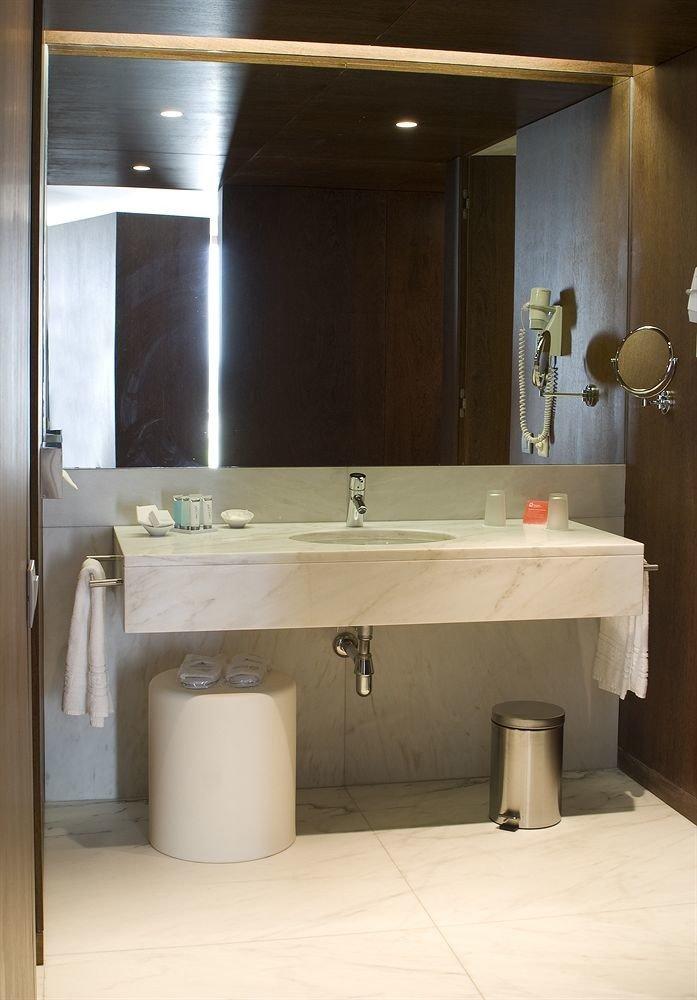 bathroom property sink plumbing fixture home bathtub toilet cabinetry Suite