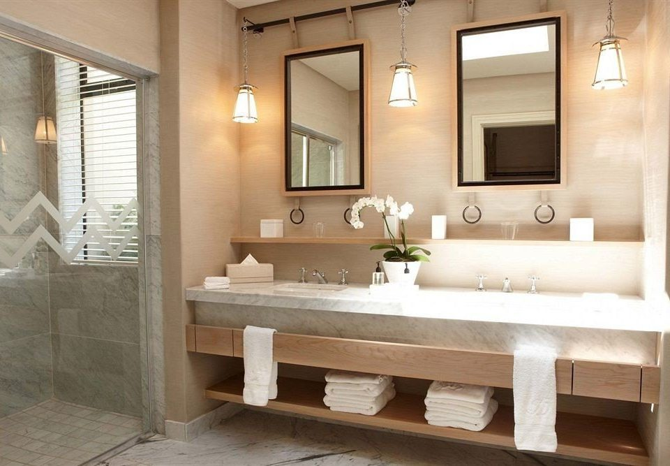 bathroom mirror sink property bathtub cabinetry plumbing fixture home white double Suite flooring tub tile tan