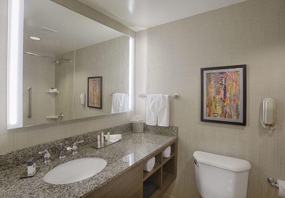 bathroom sink mirror property toilet home Suite flooring rack clean bathtub tan