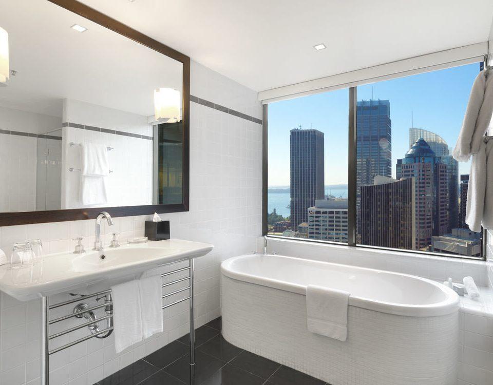 bathroom property home condominium Suite toilet tub bathtub tiled
