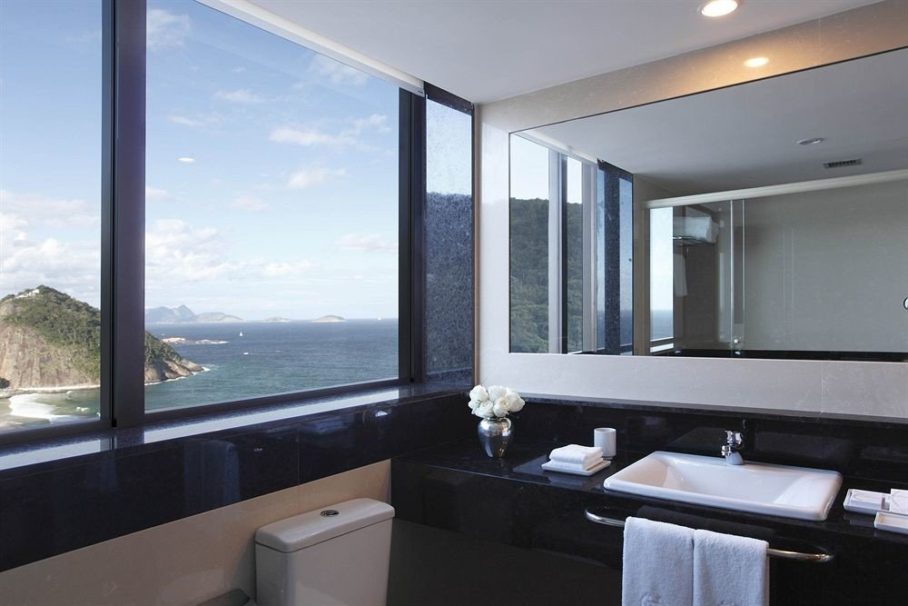 bathroom large property home condominium sink Suite counter daylighting tub bathtub