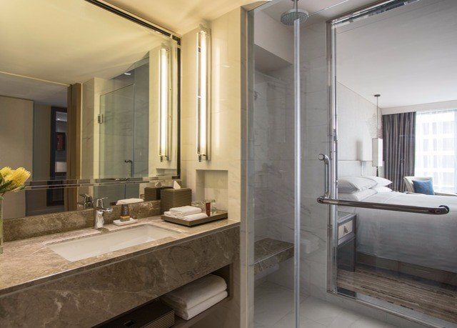 bathroom mirror property sink home Suite condominium mansion tub bathtub
