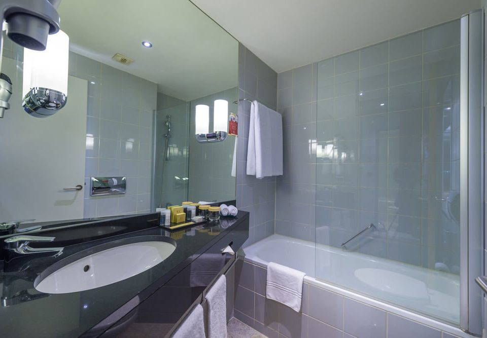 bathroom mirror sink property toilet Suite home condominium vessel bathtub counter rack