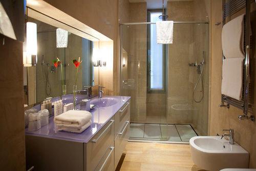 bathroom property sink home Suite cottage tub bathtub tile tan