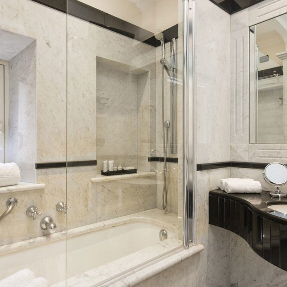 bathroom sink property mirror home toilet vehicle vessel cottage Suite mansion tan tile bathtub