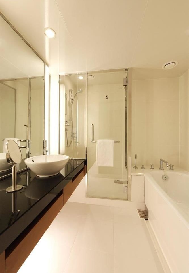 bathroom property mirror toilet sink home plumbing fixture counter flooring Suite bathtub