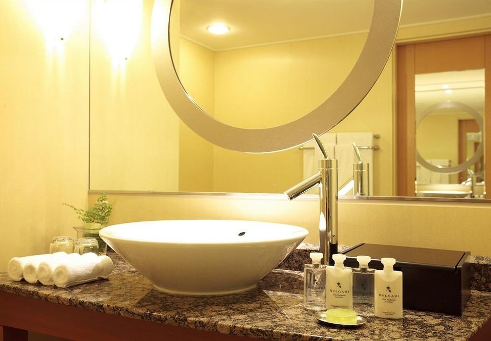 bathroom mirror sink counter Suite lighting bathtub plumbing fixture