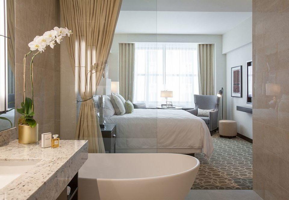 property Suite living room bathroom home curtain tub bathtub