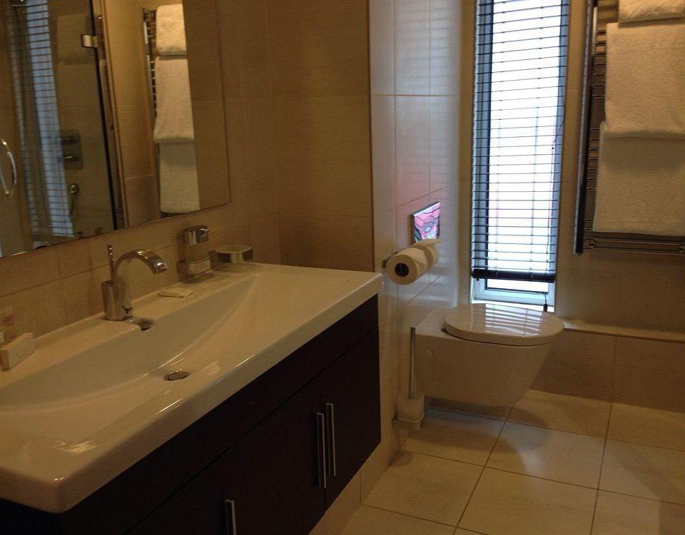 bathroom sink property house home Suite swimming pool plumbing fixture flooring tile tiled bathtub