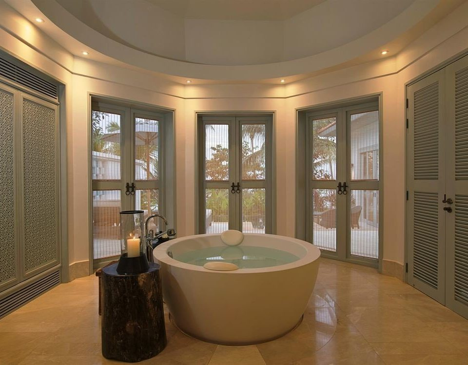 bathroom property bathtub home flooring living room Suite wood flooring