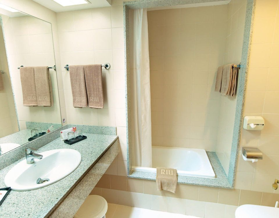 bathroom sink mirror property Suite plumbing fixture towel home public toilet bathtub