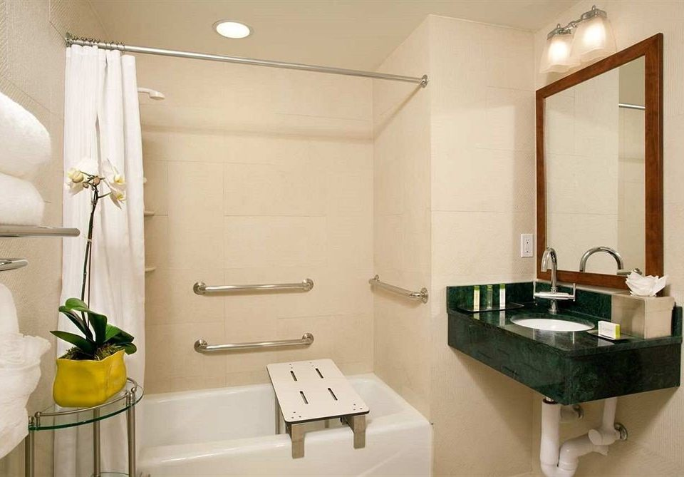 bathroom mirror sink property Suite home towel plumbing fixture bathtub rack
