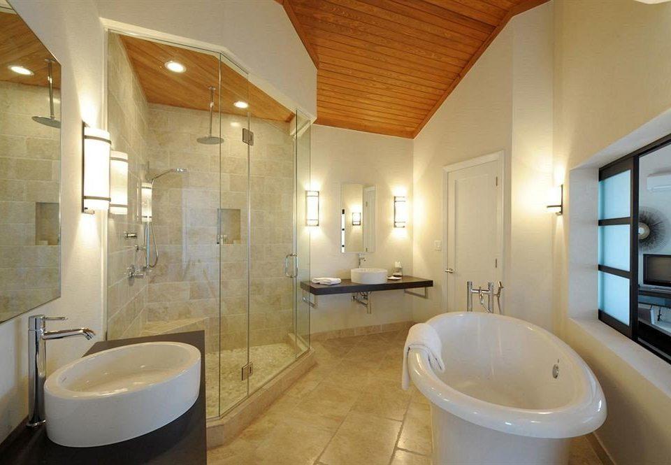 bathroom toilet property Suite sink home tub tan bathtub