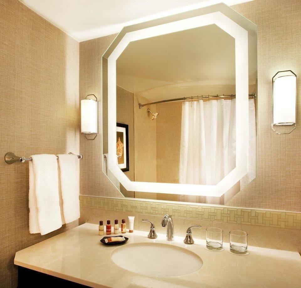 bathroom mirror sink property Suite toilet home towel plumbing fixture bathtub tile tan