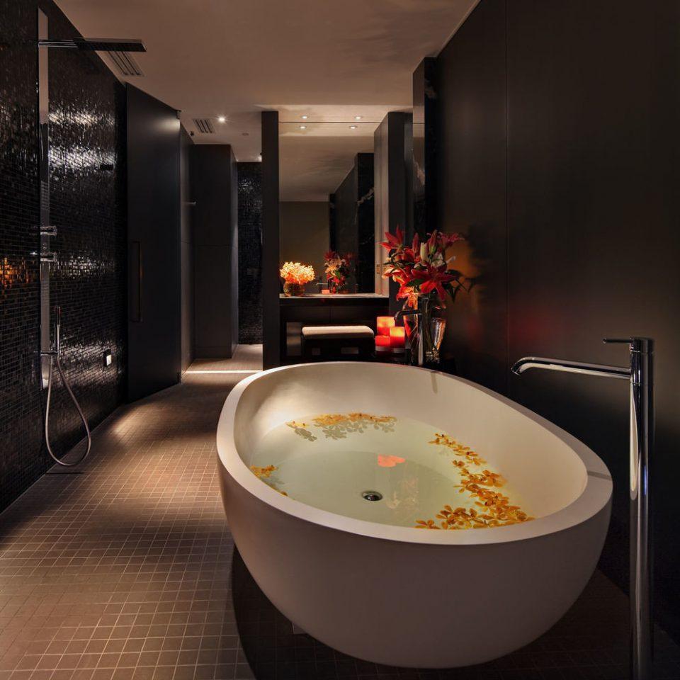 bathtub swimming pool bathroom plumbing fixture jacuzzi lighting Suite sink