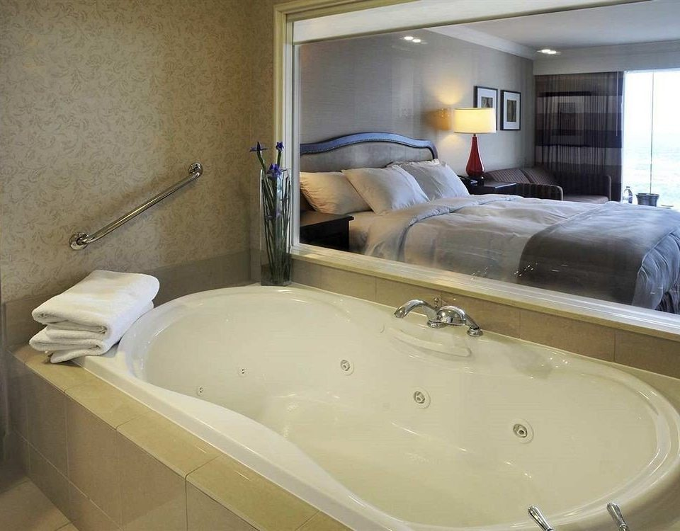 bathroom swimming pool property bathtub jacuzzi sink toilet plumbing fixture Suite tile water basin tan