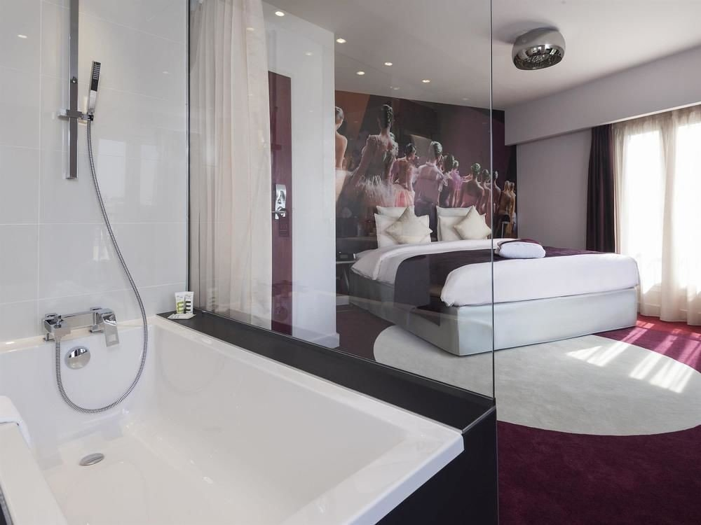 property swimming pool Suite white bathtub bathroom jacuzzi