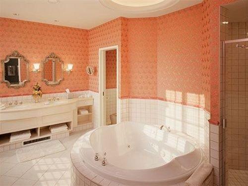 bathroom property swimming pool jacuzzi Suite bathtub tile tiled tub