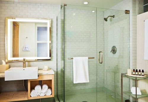 bathroom mirror sink plumbing fixture shower Suite public toilet bathtub toilet