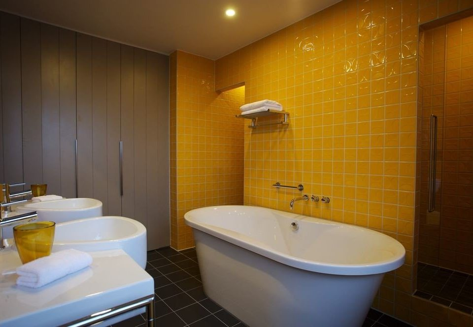 bathroom property Suite sink yellow bathtub toilet