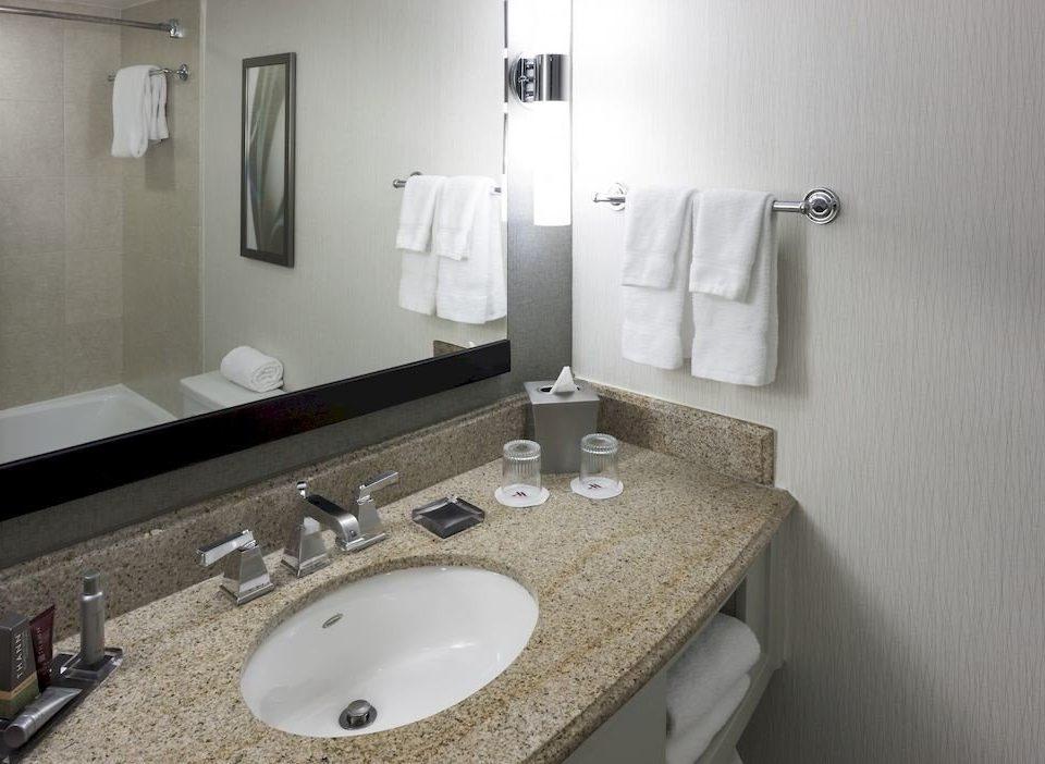 bathroom sink mirror toilet property towel bidet plumbing fixture flooring Suite vanity counter public rack clean