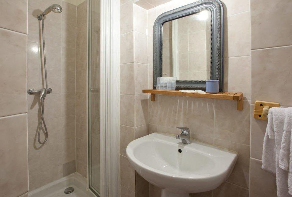 bathroom sink property white plumbing fixture bidet Suite cottage toilet tile tiled tan