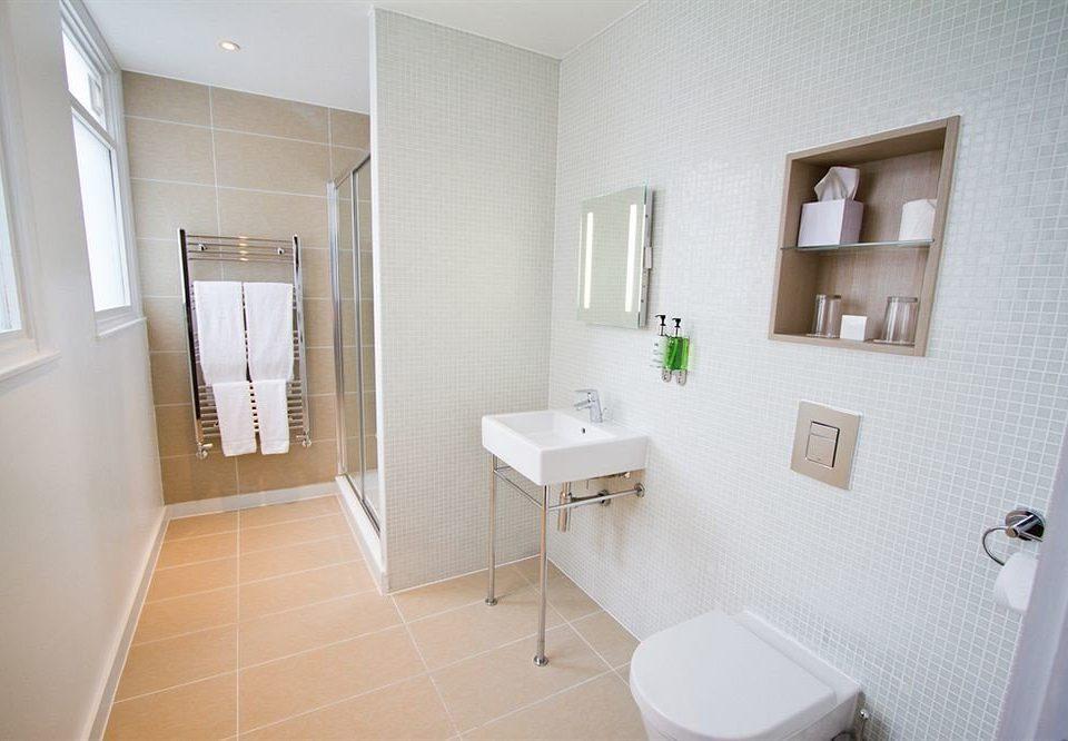 bathroom property sink home bidet cottage Suite flooring tile tiled