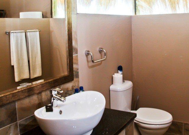 bathroom sink mirror property home bidet Suite plumbing fixture flooring