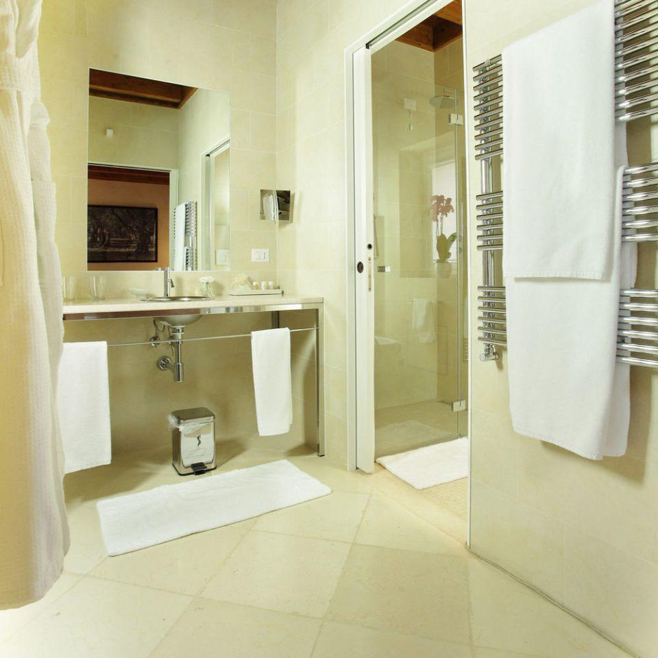 bathroom mirror property sink toilet plumbing fixture home bidet flooring Suite tiled tan