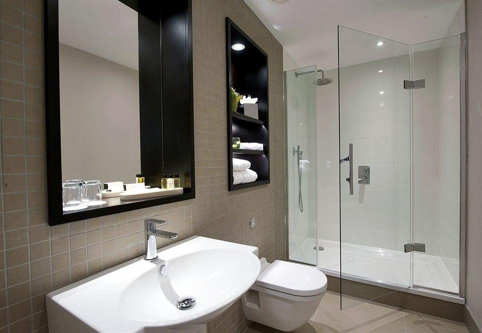 bathroom mirror property sink toilet home bidet Suite tiled tan