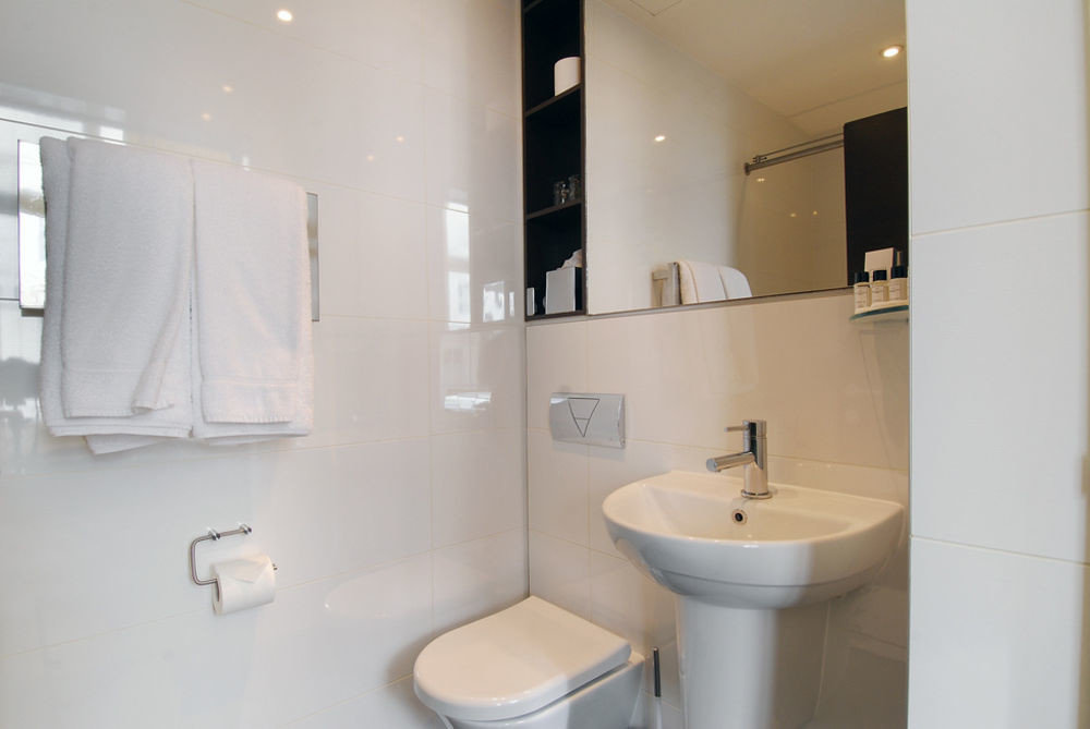 bathroom mirror sink toilet property white home bidet plumbing fixture Suite public toilet tile rack