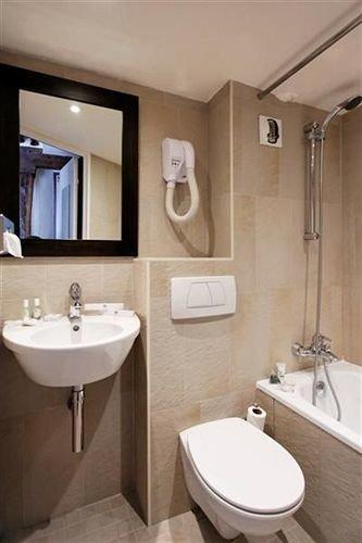 bathroom sink toilet mirror property bidet Suite