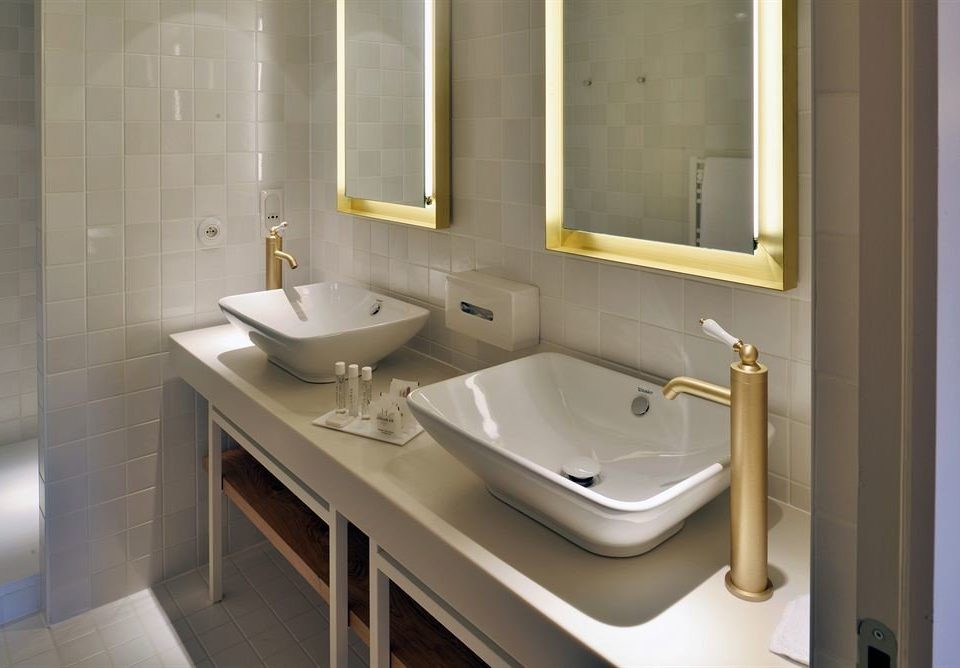 bathroom sink mirror property plumbing fixture toilet Suite bidet tan