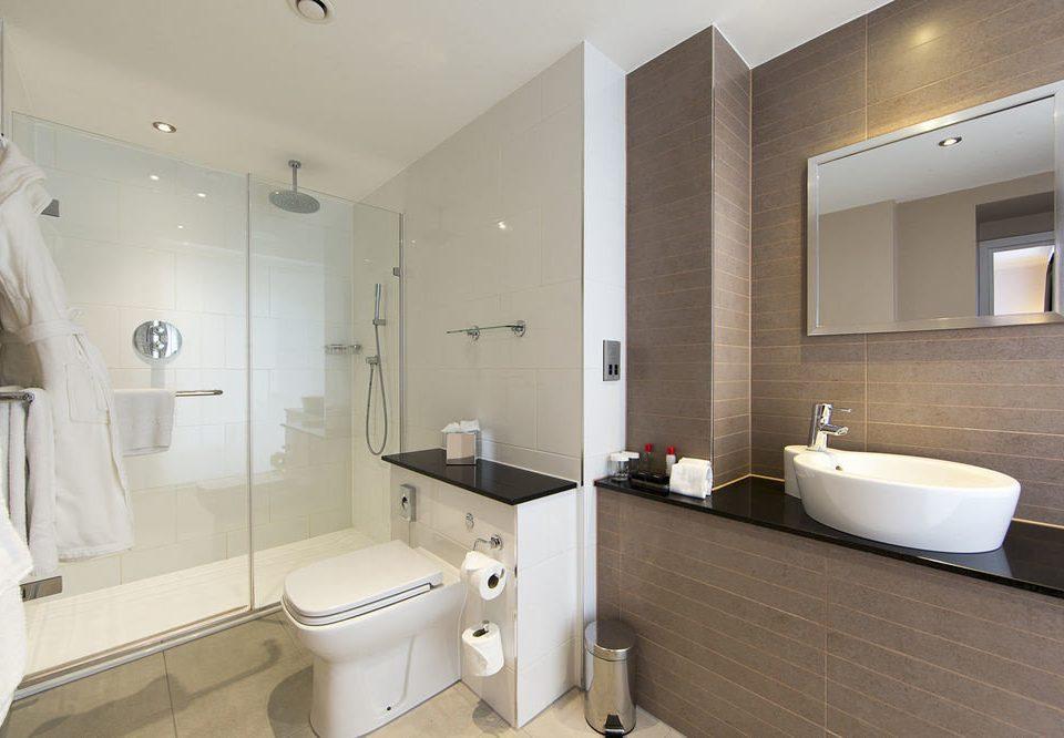 bathroom mirror property sink toilet Suite bidet tan