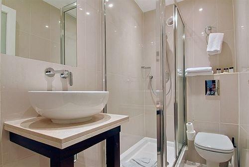 bathroom toilet property sink plumbing fixture bidet Suite public toilet tan