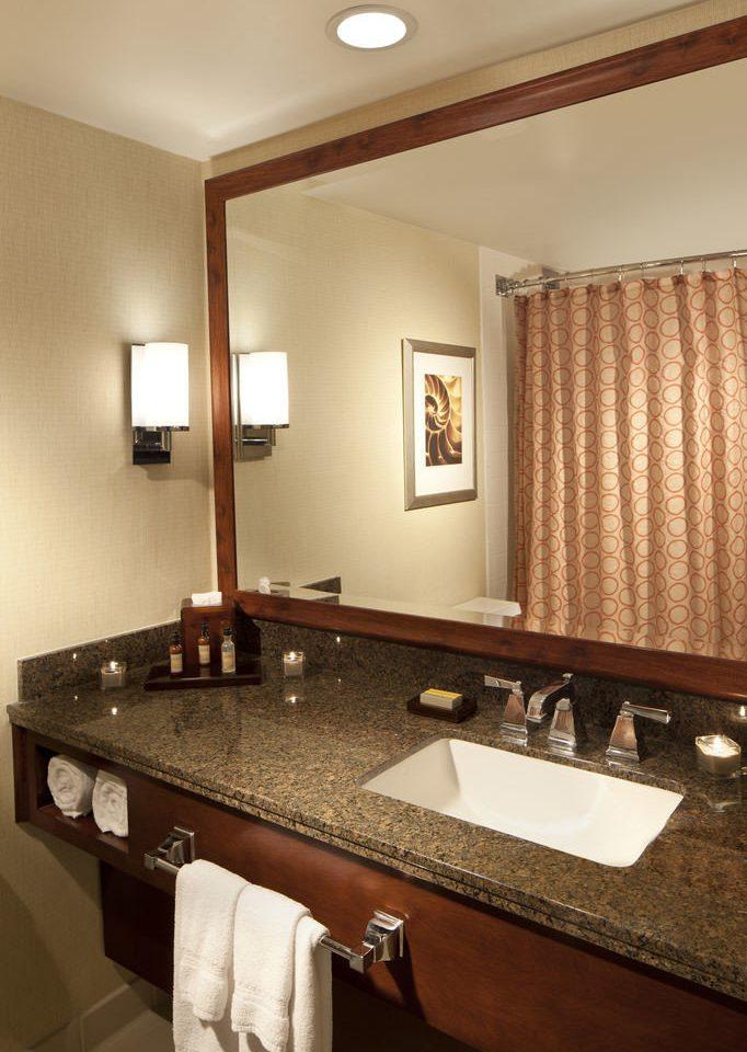 bathroom mirror sink property Suite countertop cabinetry vanity billiard room double towel tan clean rack