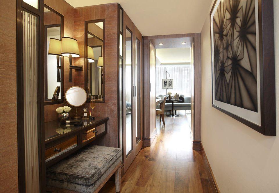 bathroom mirror building property home hardwood sink cabinetry wood flooring living room hall Suite flooring