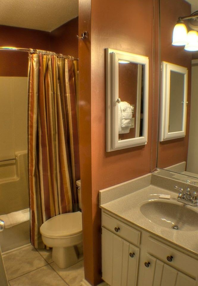 bathroom sink mirror property toilet home shower Suite cabinetry plumbing fixture clean