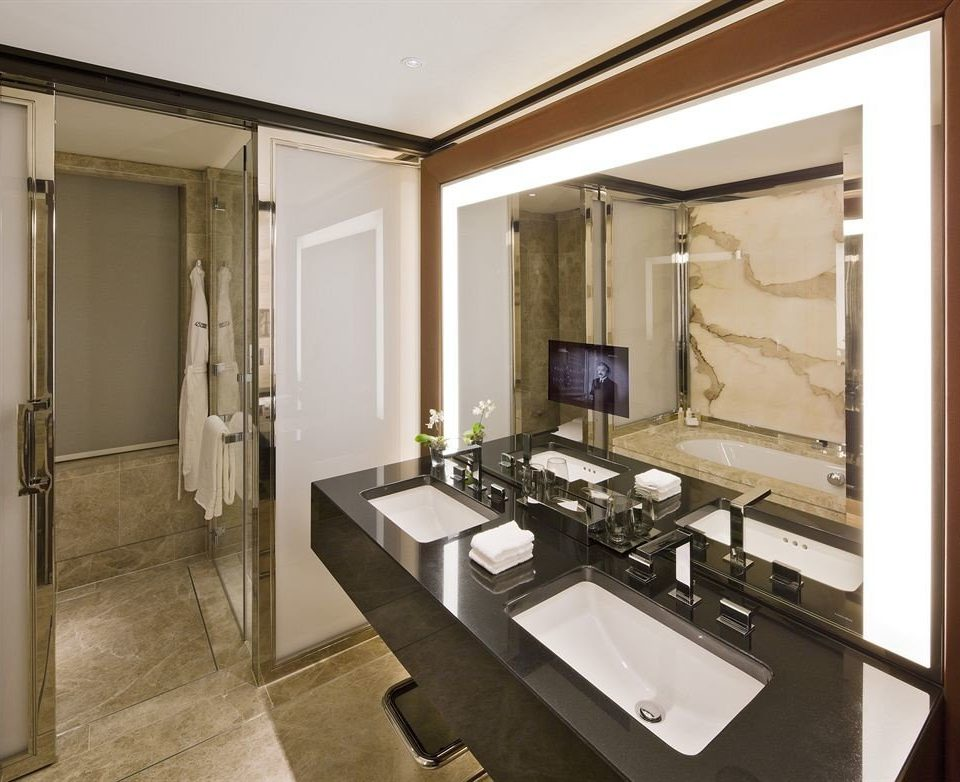 bathroom mirror property sink Suite home cabinetry cottage condominium