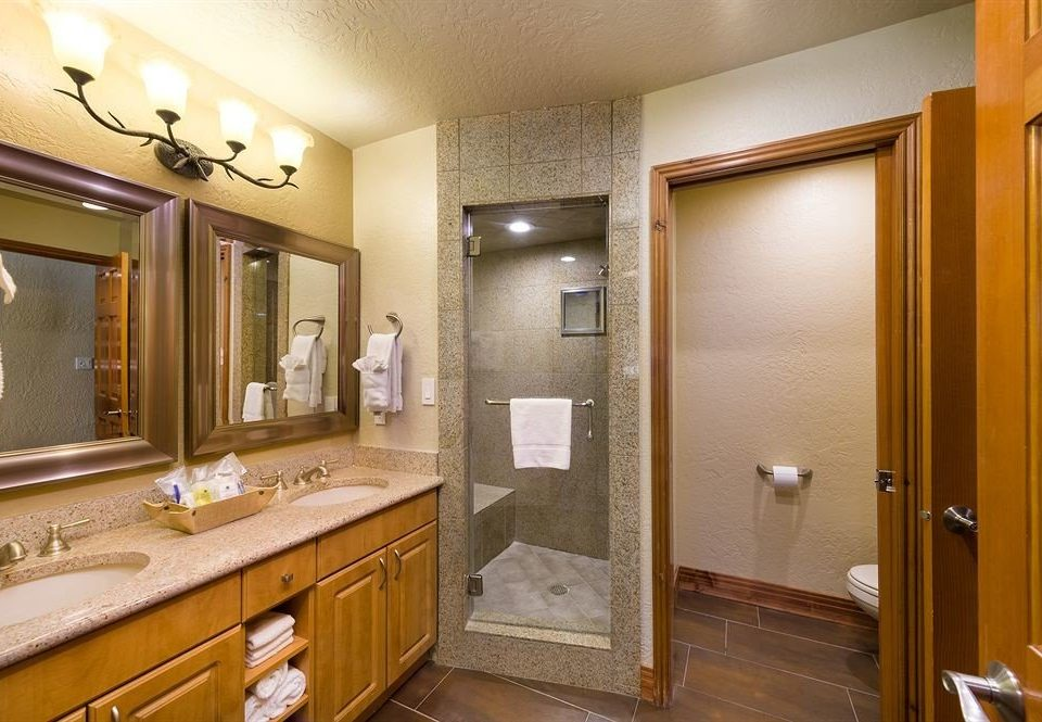 bathroom mirror sink property home Suite cabinetry vanity cottage condominium