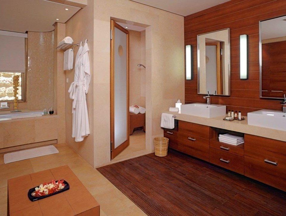 bathroom property hardwood home cabinetry cottage Suite sink flooring wood flooring