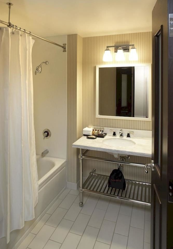 bathroom mirror property sink home cabinetry cottage Suite tile