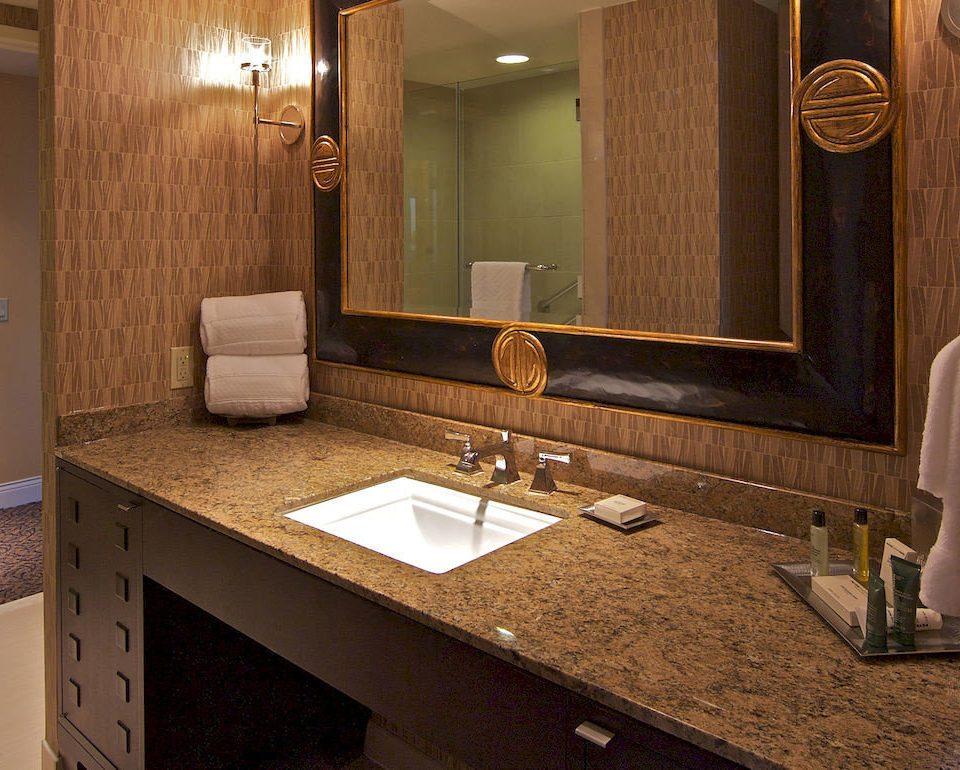 bathroom mirror sink property countertop home hardwood Suite cabinetry counter towel flooring cottage