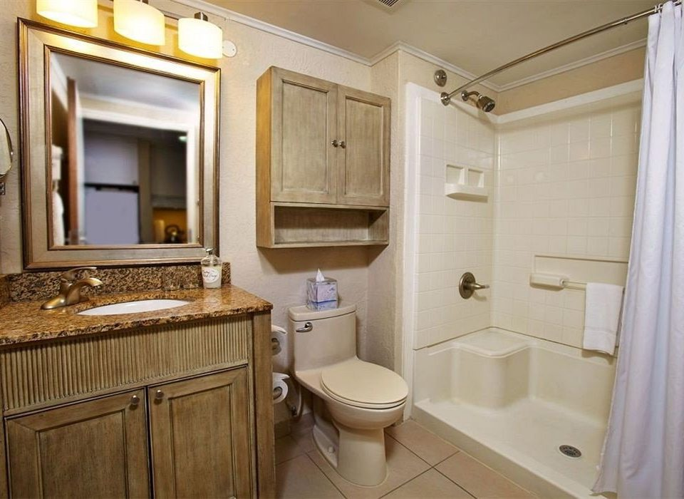 bathroom toilet property sink home cottage Suite cabinetry rack
