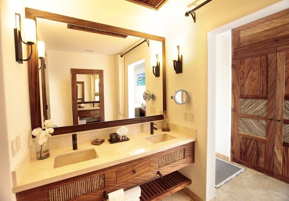 bathroom mirror property sink home hardwood cabinetry cottage Suite farmhouse mansion