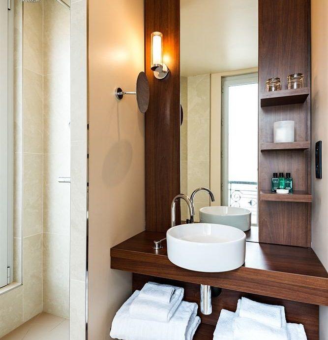 bathroom mirror sink property home Suite cabinetry cottage plumbing fixture tan