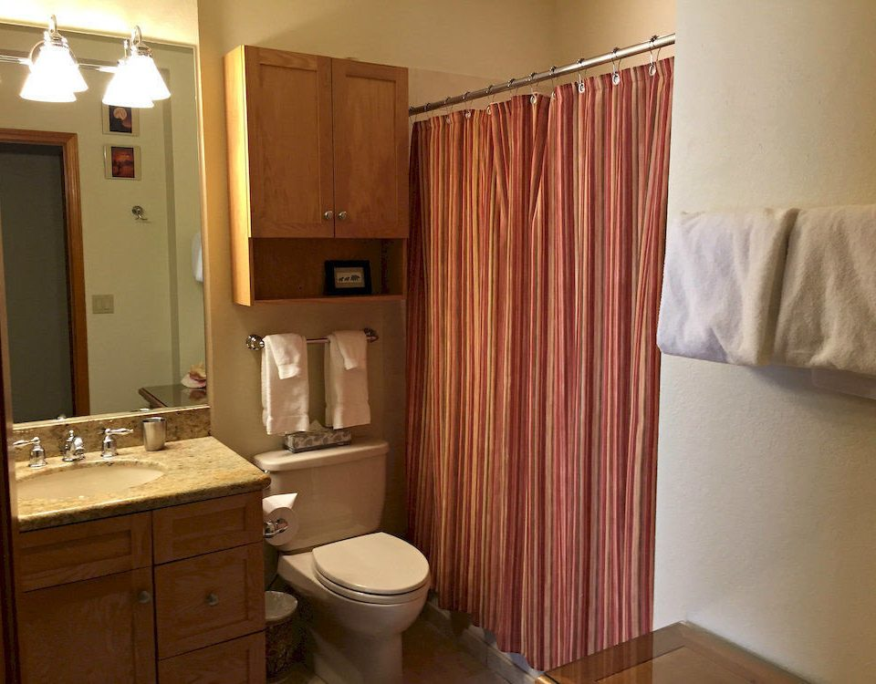 bathroom toilet property home curtain cottage Suite cabinetry material window treatment