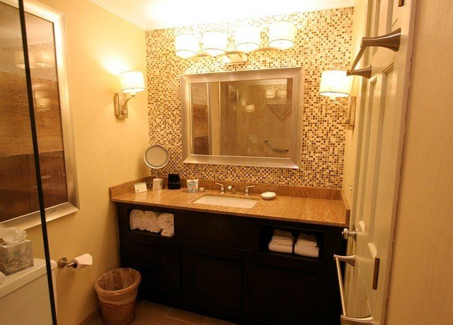 bathroom mirror property toilet sink home Suite cottage cabinetry flooring light rack