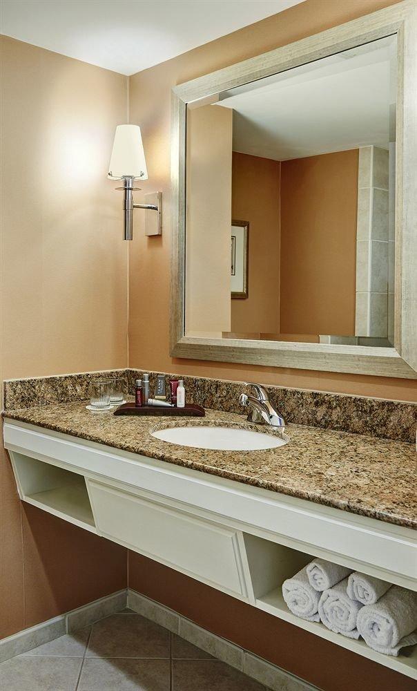 bathroom sink mirror property counter home countertop cabinetry flooring plumbing fixture Suite tan